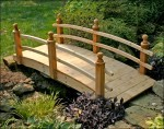 Feature arched timber garden bridge